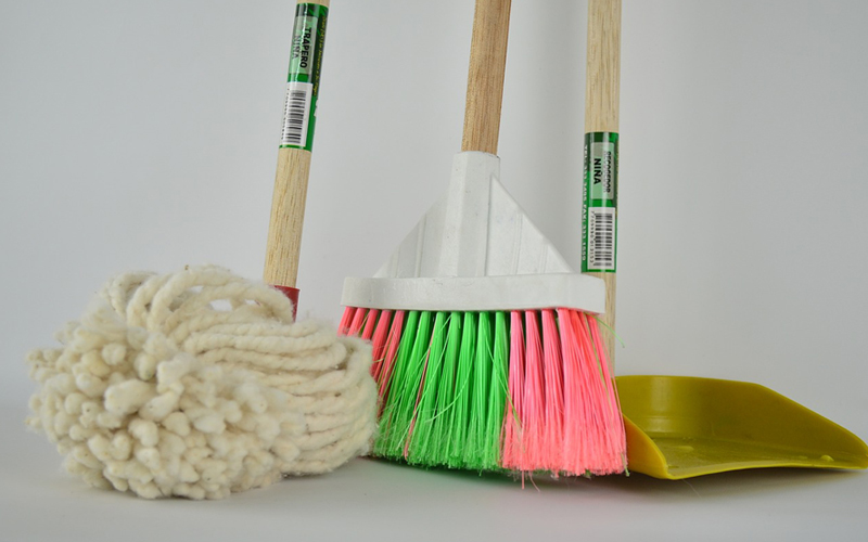 mop and brooms are the right tools for cleaning the kitchen floors