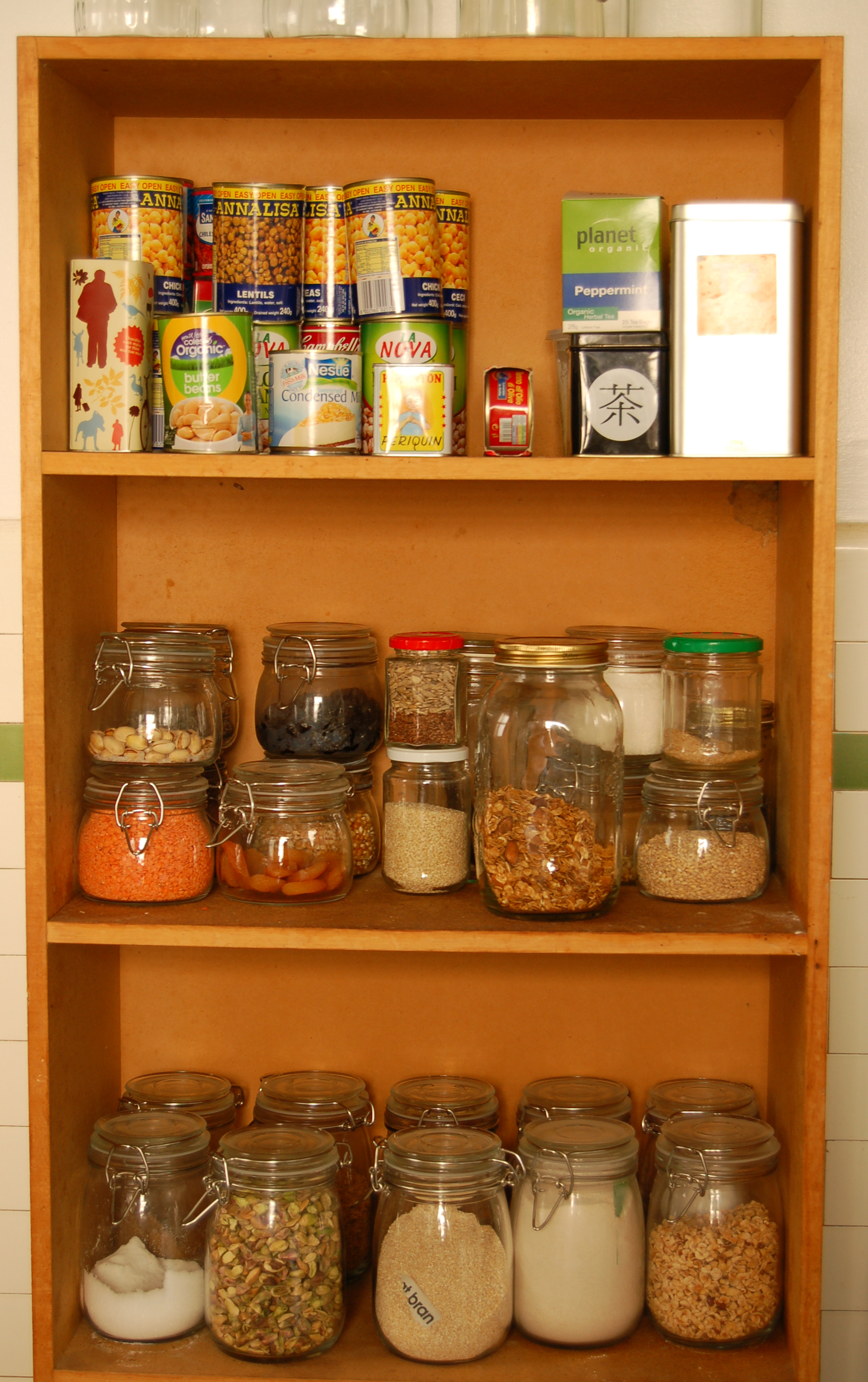 a stocked pantry full of canned goods