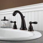 Black delta windemere faucet on bathroom