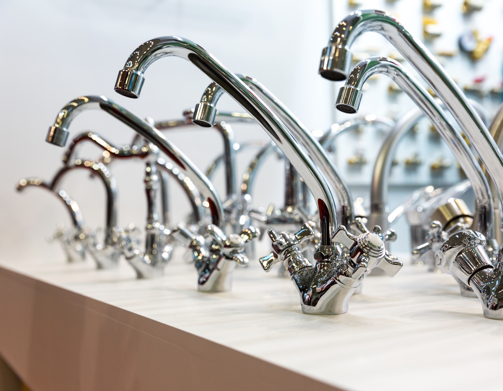 high-end kitchen faucets on a shelf