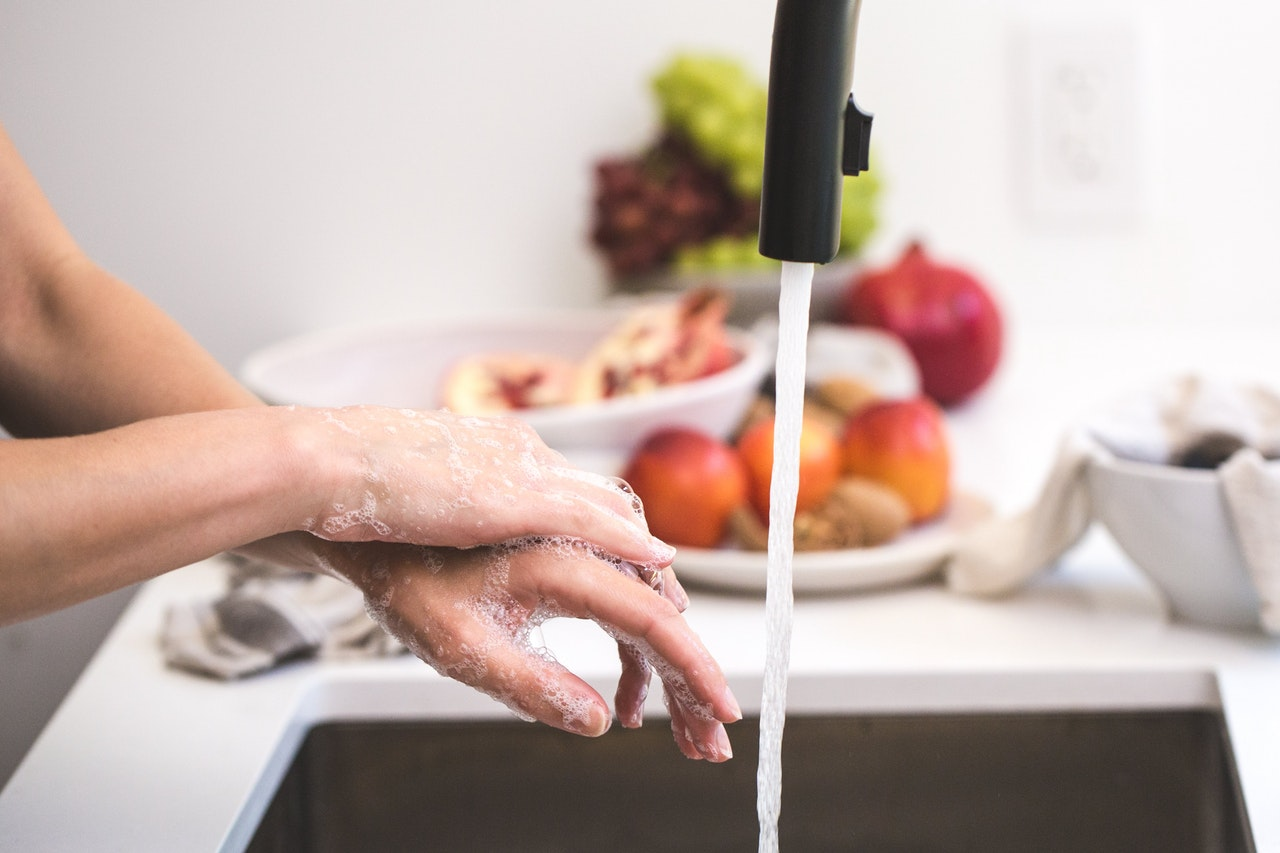 Photo of a hand near a faucet